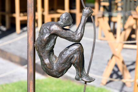 Yerevan, Armenia-April, 29 2019: man hold on to rope - part of sculptural composition in center of Yerevan, Armenia 報道画像