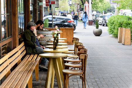 Yerevan, Armenia-April, 29 2019: Open-air cafe with small round tables on cozy street in the center of Yerevan, Armenia 写真素材