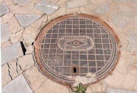 Erevan, Armenia-April, 28 2019: Sewer manhole with inscription in Russian on Erevan street. Armenia