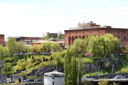 Yerevan, Armenia-April, 28 2019: View of Yerevan Brandy Factory Ararat through Hrazdan Gorge, Armenias leading alcoholic beverage company 報道画像