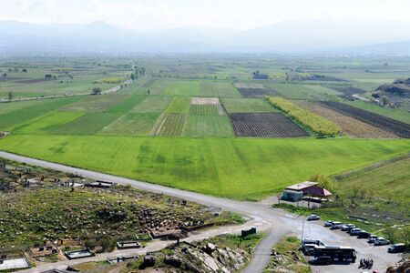 Plain with fields, gardens and plantations at foot of Khor Virap monastery near Artashat City