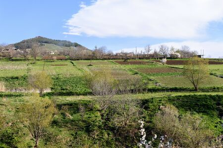 Vegetable gardens and arable lands in mountain village Tatev in spring. Armeia
