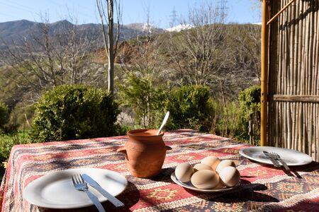 Breakfast in rustic way overlooking mountains. Tatev Village, Armenia 写真素材