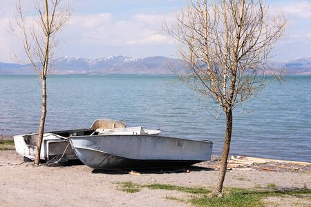 Two boats on shore of Lake Sevan in spring. Armenia 写真素材