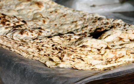 Freshly baked thin sheets of pita bread - traditional Armenian bread. National Armenian cuisine