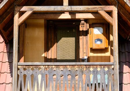 Balcony with a carved wooden fence and a lighthouse in the center of Dilijan, Armenia 写真素材