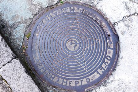 Dilijan, Armenia-May, 02 2019: Sewer manhole with inscription in Russian on Erevan street. Armenia
