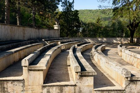 Spectator seats of Old Amphitheater in small resort mountain city Dilijan in Armenia