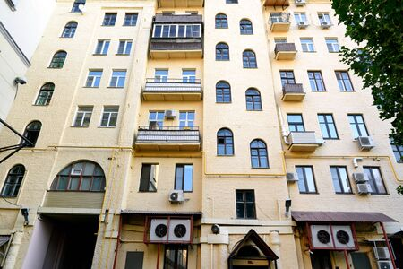 Multi-storey yellow residential building in center of Moscow. View from yard 写真素材