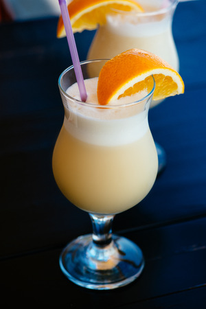 colada: Pina colada in a glass on the table Stock Photo