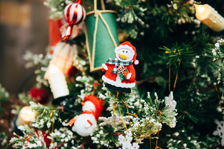 christmas toy: Christmas toy snowman hanging on Christmas tree