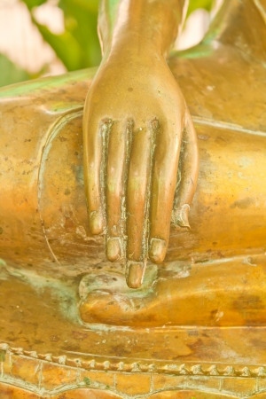 Hand of golden buddha image in Thailand photo