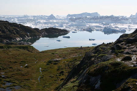icefjord: The Sermermiut valley and the Icefjord near Ilulissat, Greenland Stock Photo