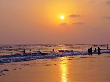 people enjoying sunset over Bay of Bengal, Coxs Bazar, Bangladesh