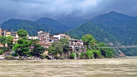 Lakshman Jhula crossing holy Ganges River in Rishikesh, India