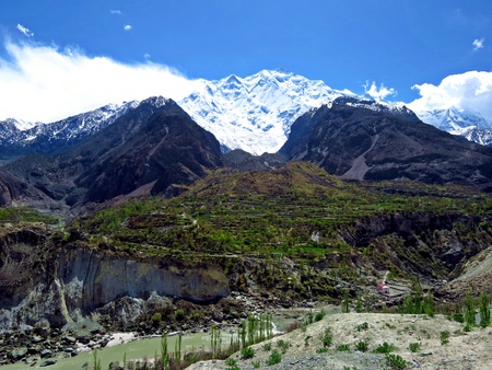 Rakaposhi mountain is one of the highest mountains near Hunza valley. It is ranked 27th highest in the world and 12th highest in Pakistan. Rakaposhi means Snow Covered in the local language.