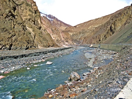 The Indus River is one of the longest rivers in Asia. It flows in a southerly direction along the entire length of Pakistan to merge into the Arabian Sea near the port city of Karachi in Sindh. It is the longest river and national river of Pakistan. Фото со стока