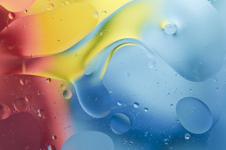 prety: Abstract pattern of colored oil bubbles on water Stock Photo