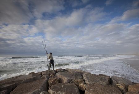 Fishermen standing on the rocks