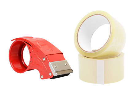 Tools for packing. Two transparent tape rolls for packing and one red tape cutter, on white background.