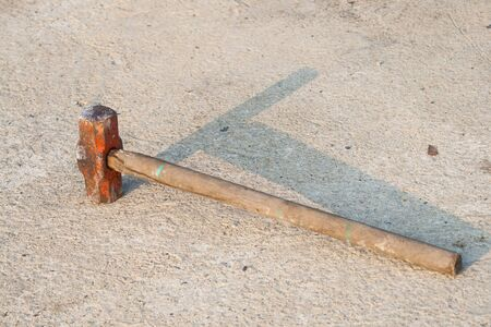 wood stick Sledge Hammer on the ground