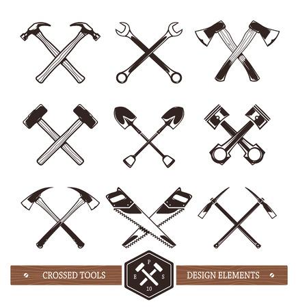 Vector attraversato strumenti di lavoro duro. Set di elementi utili per emblemi, distintivi o altri disegni retrò.
