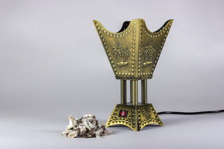 Golden censer incense burner isolated on white background