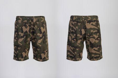 Sport shorts ,camo color, front and back view isolated on white.