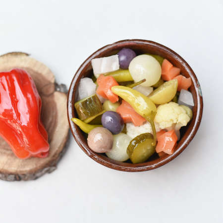 Pickled olives, cucumber and pepper Homemade organic lightly salted cucumbers Appetizer. Organic, healthy food. Pickled vegetables on the wooden white background