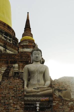 Ancient Buddha statue in archaeological site. Stock Photo