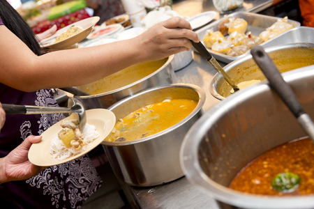 thai people: Thai vermicelli eaten with curry, breakfast for thai people