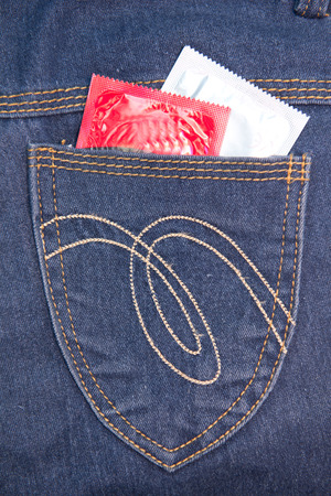 two condom in jeans pocket photo