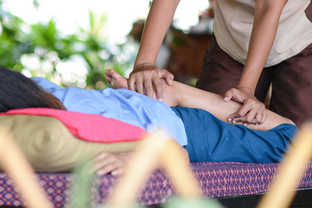 girl is relaxing from massage by professional therapists, Spa room photo