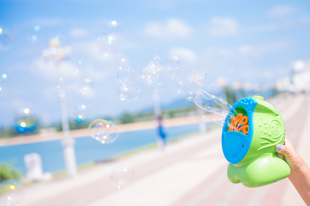 play bubble machine toy for kid in nice day