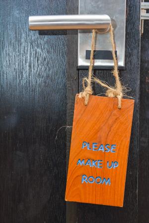 please make up room sign on wood, door