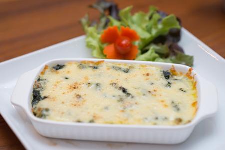 cheesy: Cheesy Spinach Casserole, food Stock Photo