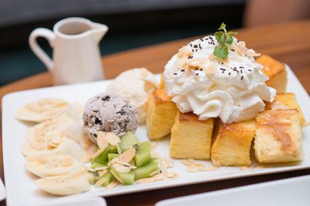 serve: Honey toast and ice-cream serve with banana and kiwi, dessert