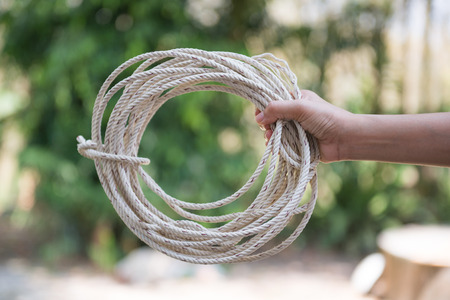 lasso: hand holding rope for a bundle, lasso Stock Photo