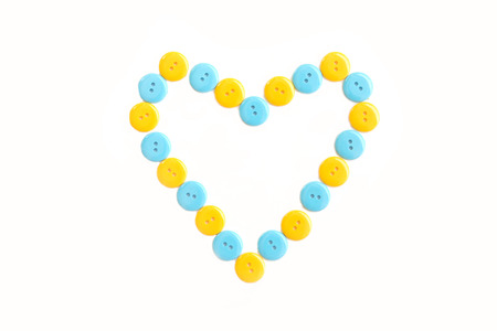 yellow heart: blue and yellow heart from plastic clasper, valentine Stock Photo