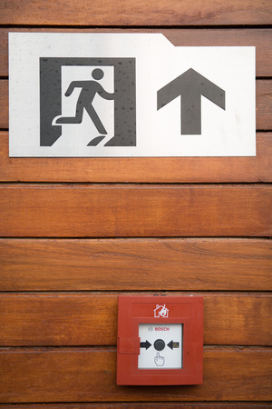 emergent: fire exit signs and keypad alarm fire, emergent Stock Photo