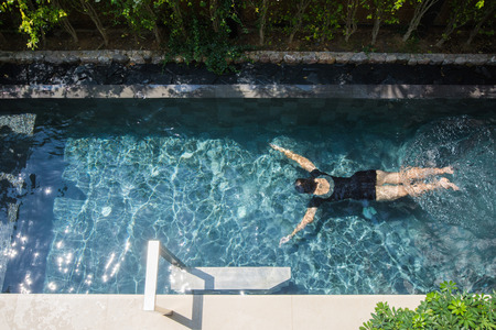 woman is relaxing on the private pool villa, water