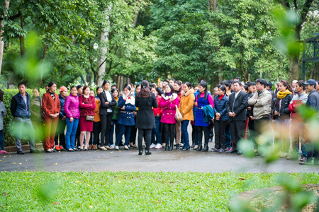 waited: Hanoi, Vietnam Mar 12:: Guides are informative for travelers to visit the House of Ho Chi Minh on March 12, 2015 Vietnam