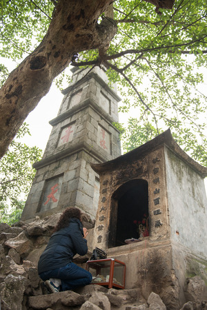 13: Hanoi, Vietnam Mar 13:: woman wish to pray for blessings at Ngoc Son Temple, Hanoi city on March 13, 2015 Vietnam Editorial