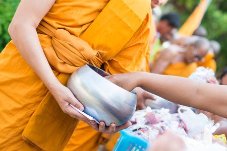 alms: Thailand 13 Apr :: give alms to a Buddhist monk in Songkran Festival , on 13 April 2015 Thailand