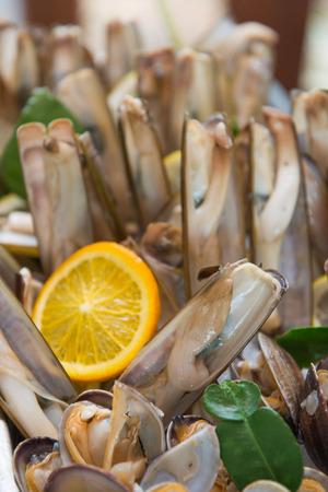 fresh razor clam on buffet line seafood, food photo