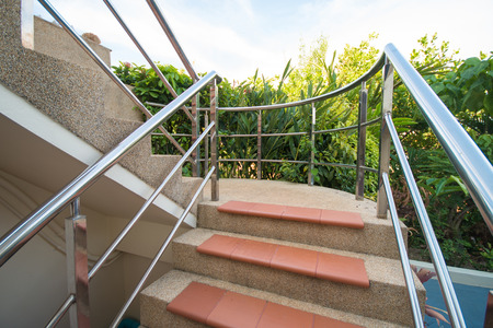 handrails: Stone staircase with stainless steel handrails, architecture Stock Photo