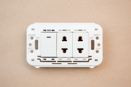 switches: white switches and outlet , electricity Stock Photo