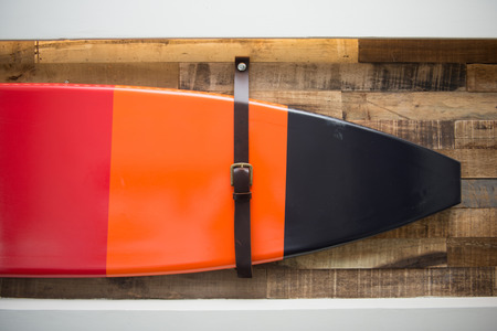 wall decor: beautiful surf board hang on the wood wall, home decor Stock Photo