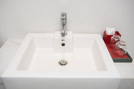to sink: faucet on basin in bathroom, sink Stock Photo