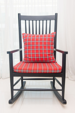 classic living room: classic chair with red plaid pillow in living room Stock Photo
